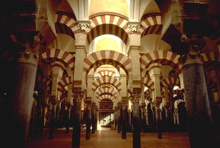Former Mosque of Cordoba, Spain --The interior of the Cathedral of Cordoba, formerly the Great Mosque of Córdoba. The cathedral is one of the finest examples of Arab-Islamic architecture in the Umayyad style. An Islamic Mosque (742) built on the site of the Visigothic Christian 'Saint Vincent basilica' (600) then reconquered for the Christian Catedral de Nuestra Señora de la Asunción in 1236.