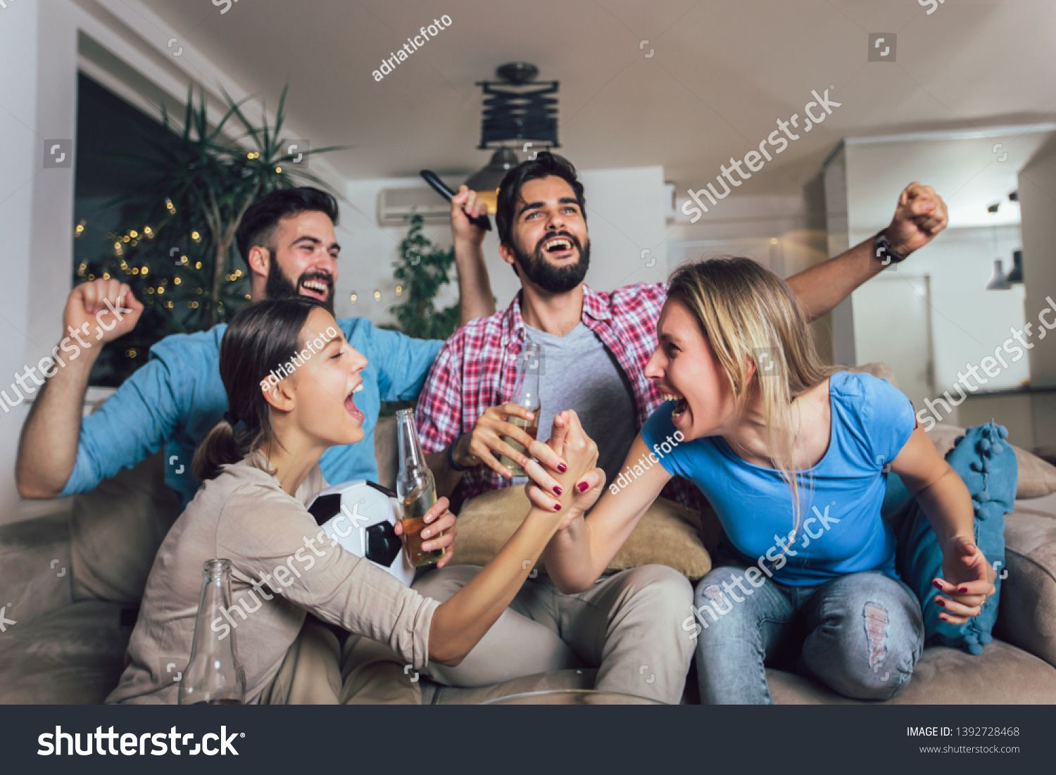 Happy Friends Or Football Fans Watching Soccer On Tv And Celebrating Victory At Home Friendship Sports And Entertainment Football Fans Happy Friends Soccer Tv