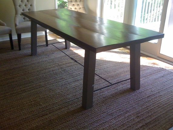 Farm table with metal struts.