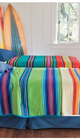 Love this idea for a beach house or boys room some day. Pendleton blankets and surfboards.
