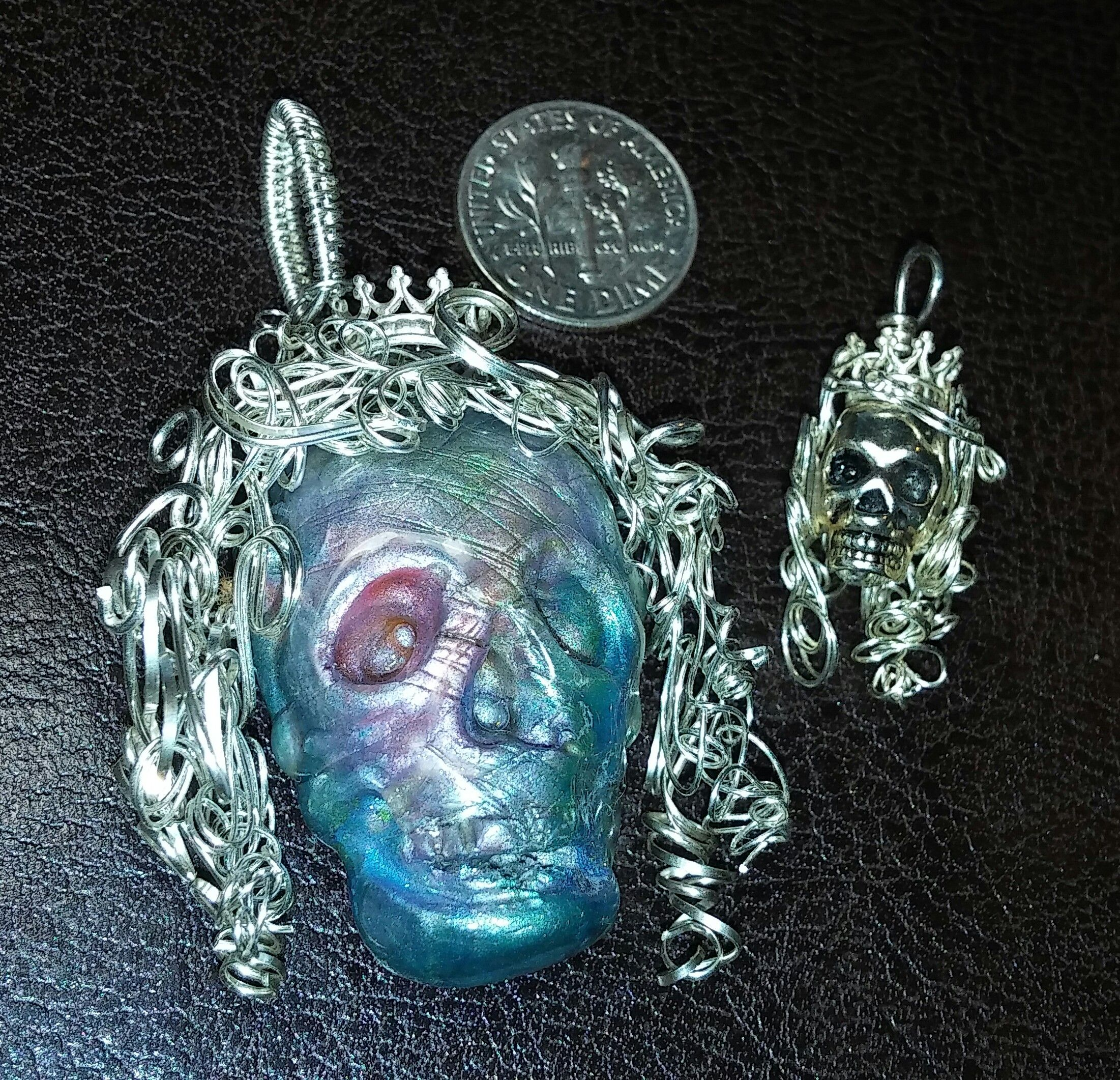 More Faux Labradorite-ite. :) The blue skull is clay and the wire is ...