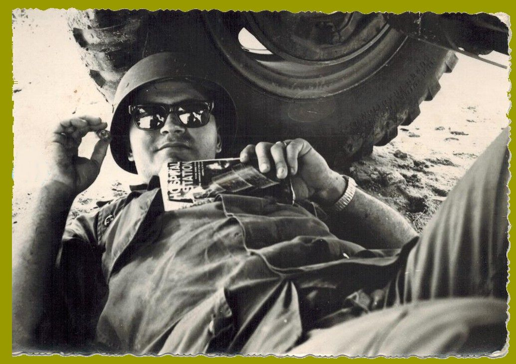 James Wright - So characteristic, a pocketbook in hand. Resting under vehicles is generally frowned upon these days. Guess the safety nazis weren't so strict back then. Note the title of the book he's reading. Army even in his off time.