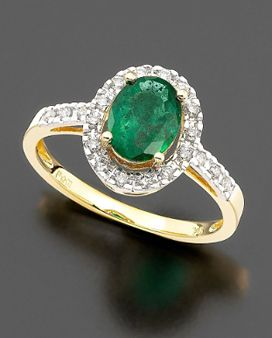 If the main stone were a different stone than an emerald I would love this ring