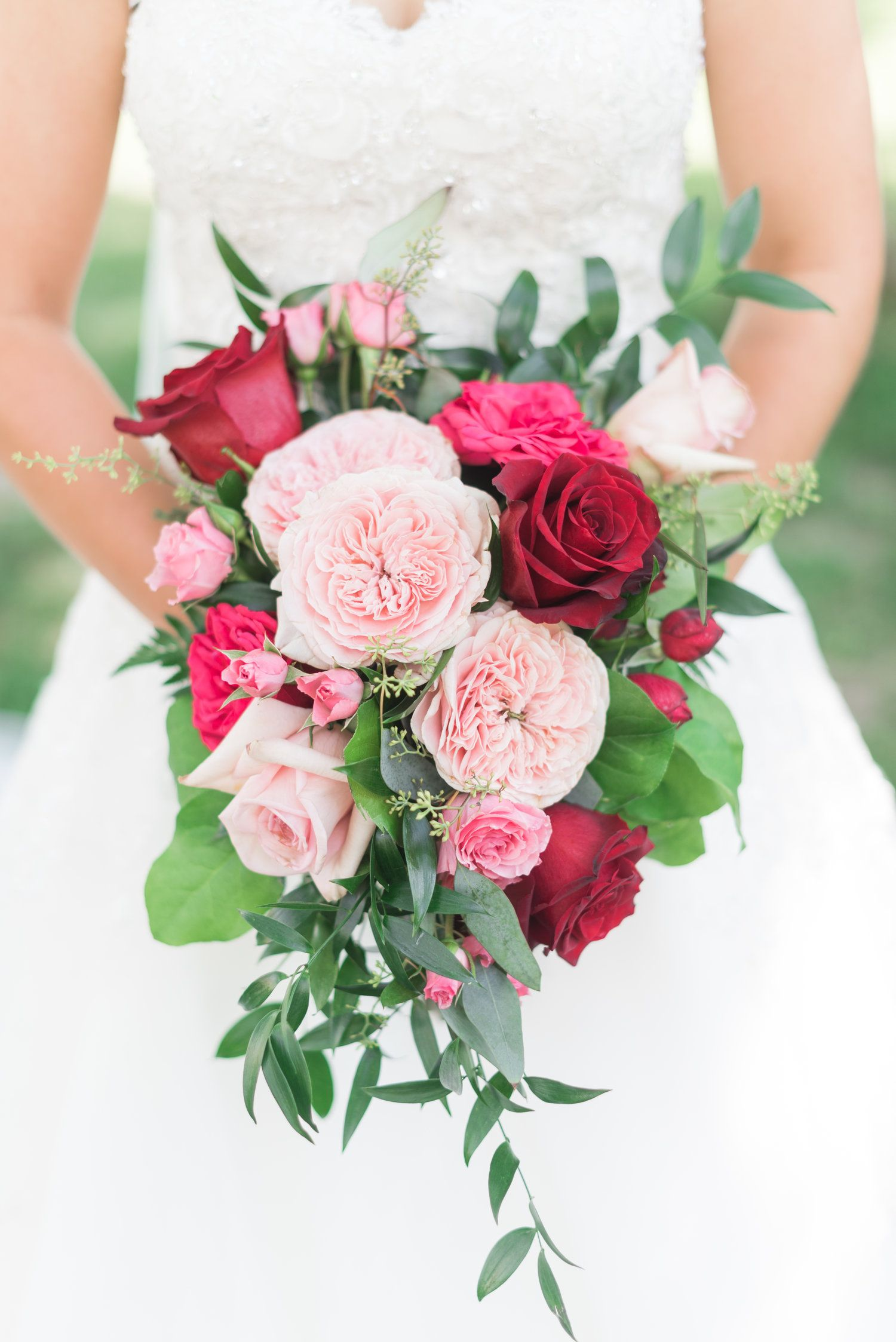 des moines wedding florist // eucalyptus and pink roses, red