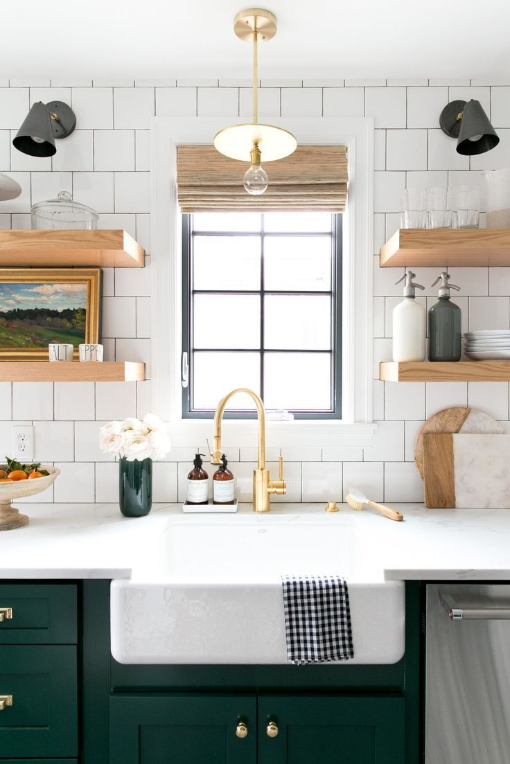 Bold green cabinets and open shelving in the kitchen denver tudor