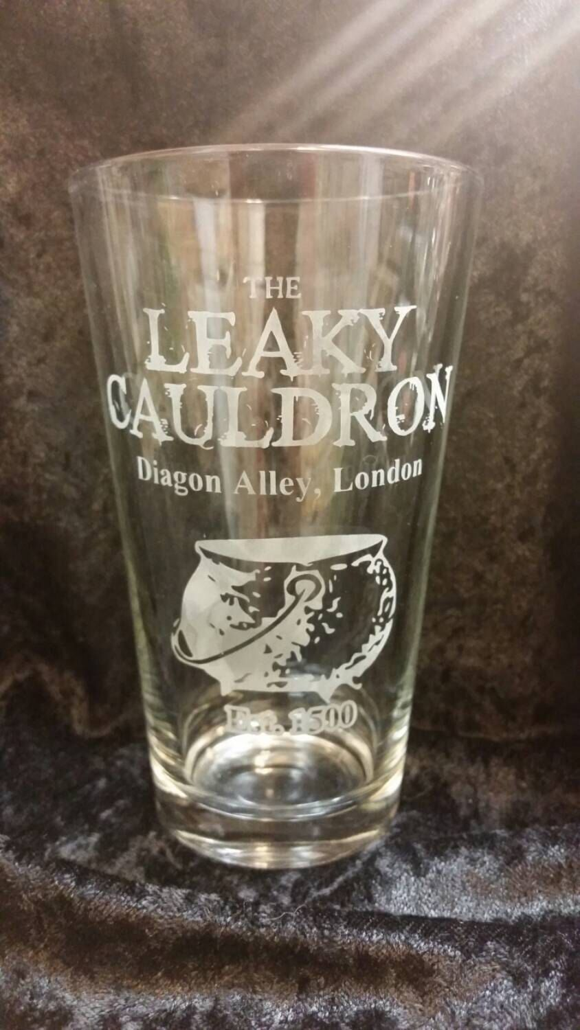 The Leaky Cauldron Harry Potter Pub Inspired Etched Glassware Diagon Alley London Est 1500 Etched Pint Glass Harry Potter Pint by SilverblattDesign on Etsy https://www.etsy.com/listing/241225037/the-leaky-cauldron-harry-potter-pub