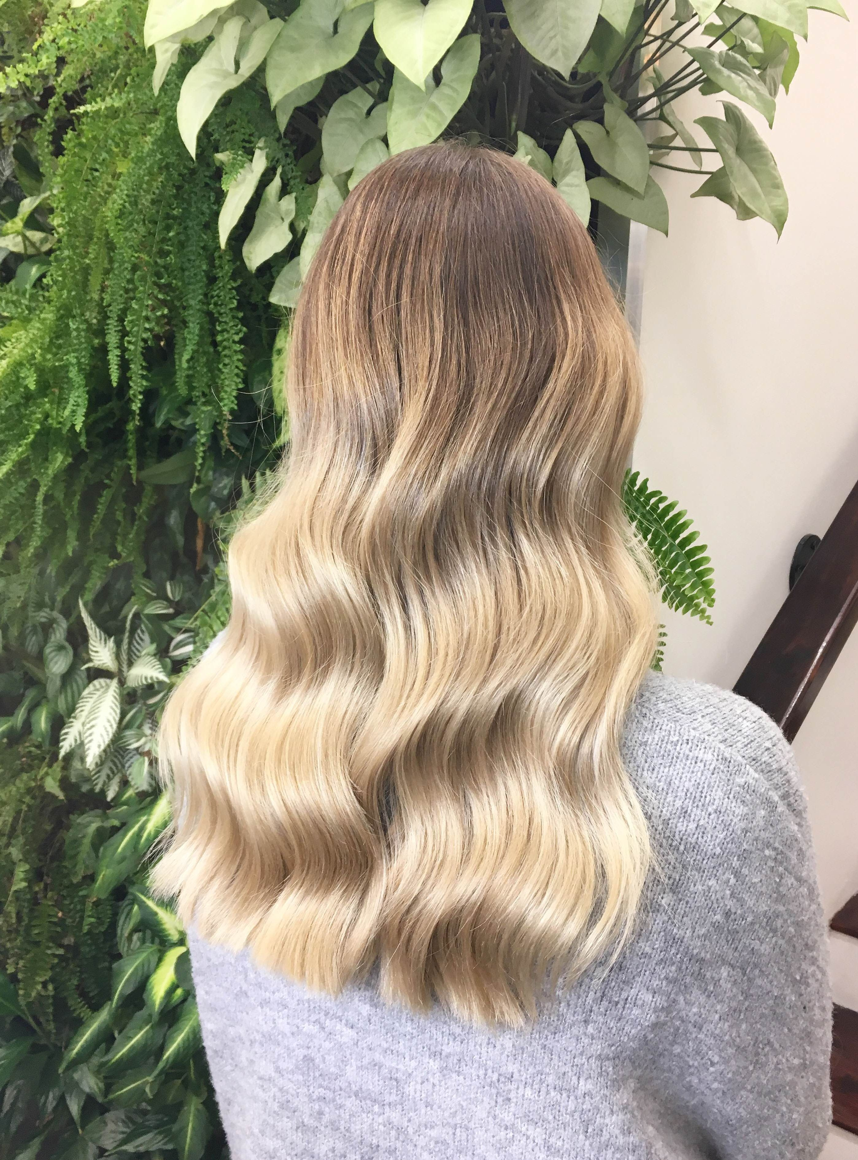 The Vertical Pull Down Is The Easiest Hair Trick You Ll Learn