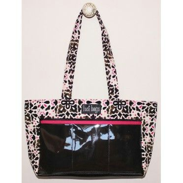 The display purse. It has 3 windows on the front. This bag is great for those who don't like to carry a huge purse. It comes in a variety of patterns.   www.lucibags.com/party/mayrapriddyparty