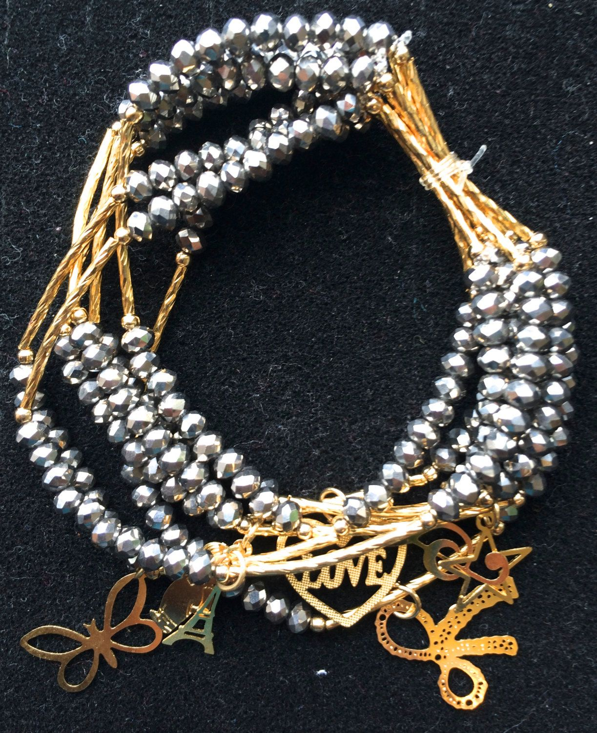 Bracelet Made Of Silver Colored Crystal Like Beads With A Gold Charm Semanario Set