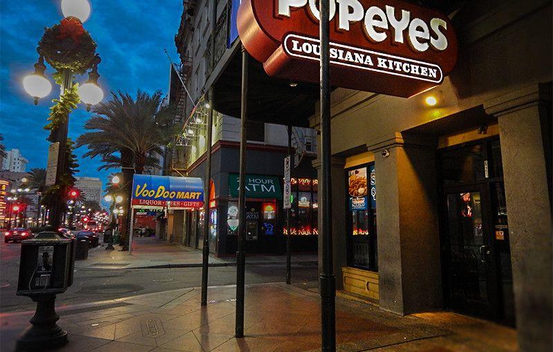 NOV 19, 2015 - Popeyes Chicken from sidewalk along Canal Street at dawn in New Orleans, LA/photonews247.com