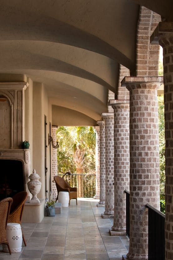 Loggia With Round Tapered Brick Columns Plaster Groin Vaults And Stone Mantel American Architectural Detail Brick Columns Stone House Plans Architect House