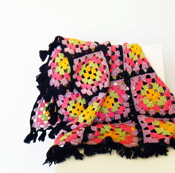 A simple granny square, looking fantastic given the black join and ...