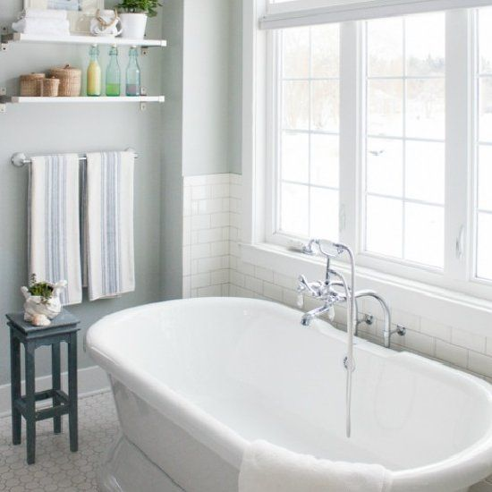 Crisp White And Grey Master Bath, Featuring A Pedestal Tub And A Gorgeous Lake View