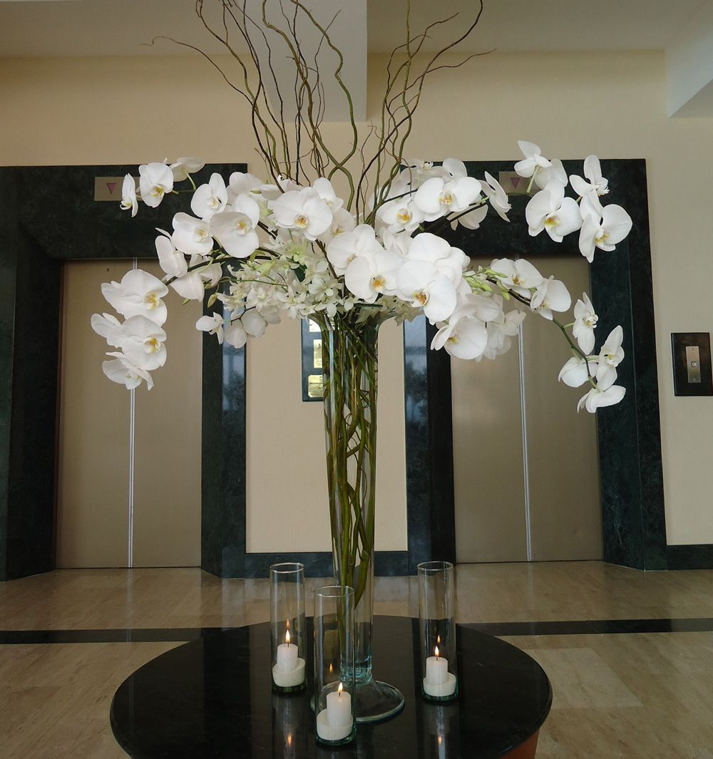 White phalenopsis orchid centerpiece on a tall quot height