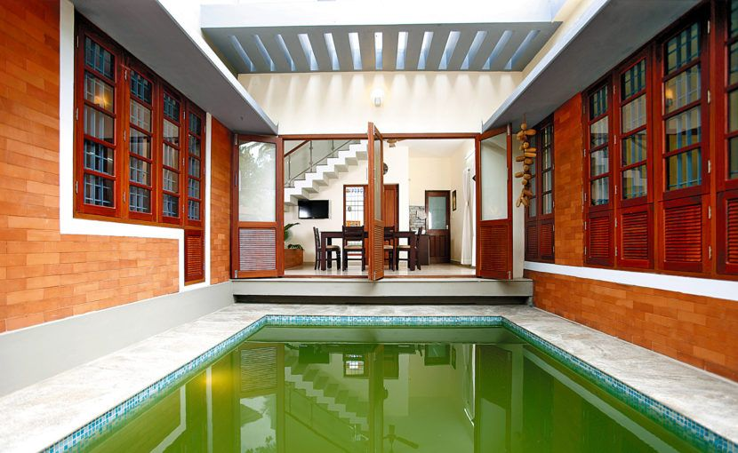 Kerala house built around a pool pond house traditional for Pool design in kerala