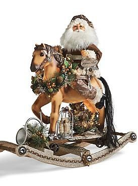 Boasting exceptional elegance and stunning design, the Lighted Platinum Rocking Horse Santa is the perfect accent piece for your holiday collection.