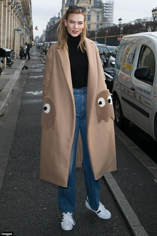 Karlie Kloss wearing Adidas Originals Superstar Sneakers, Wolford Colorado Bodysuit in Black, Anya Hindmarch Oversized Coat Ghosts in Camel Wool with Shearling Trim, Ray-Ban Wayfarer Sunglasses and Imogene + Willie Catherine High Waist Wide Jeans in Vintage