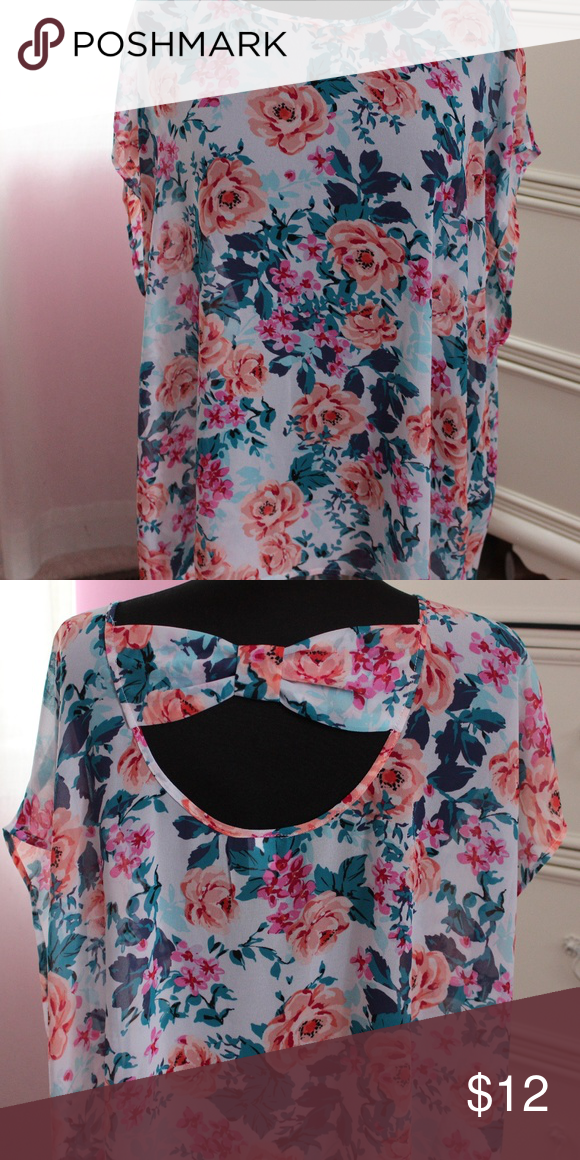 Torrid sheer floral top This top is super cute and perfect for the warm weather. The material is super lightweight and breathable. Also the back of the top is super cuter with the bow cutout. Brand new but the tags were removed. torrid Tops Tees - Short Sleeve