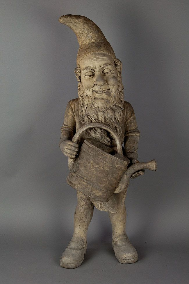 A Terracotta Garden Gnome With Watering Can Ca 1920