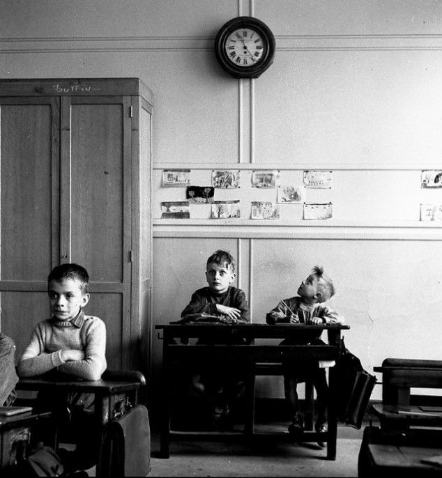 Young boys trying so hard to make it to the end of the school day, 1956...