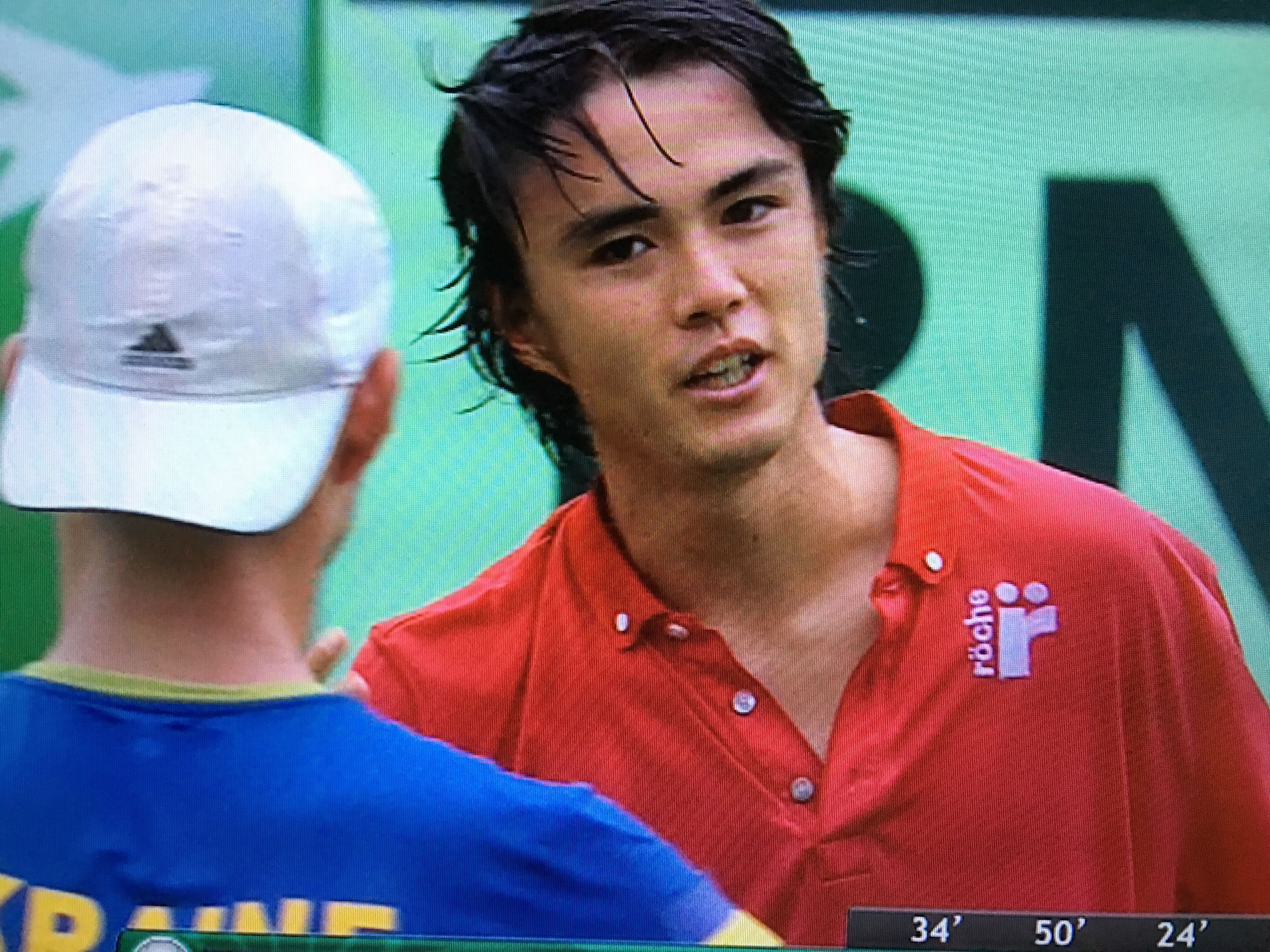 Taro greets at net upon winning at Davis Cup 2016