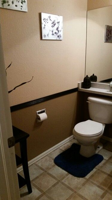 Two Tone Brown Paint With Black Border In Half Bathroom.