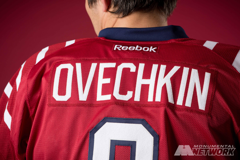 d119bfb9a Washington Capitals captain Alex Ovechkin shows off the Caps  2015  Bridgestone NHL Winter Classic® jersey
