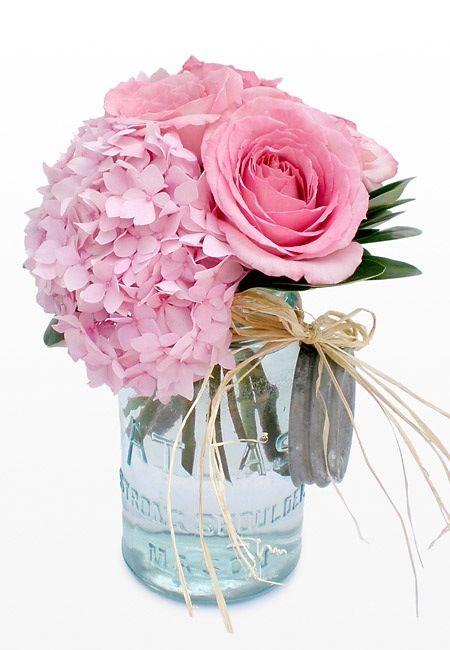 So pretty from blue mason jar to hydrangea and roses
