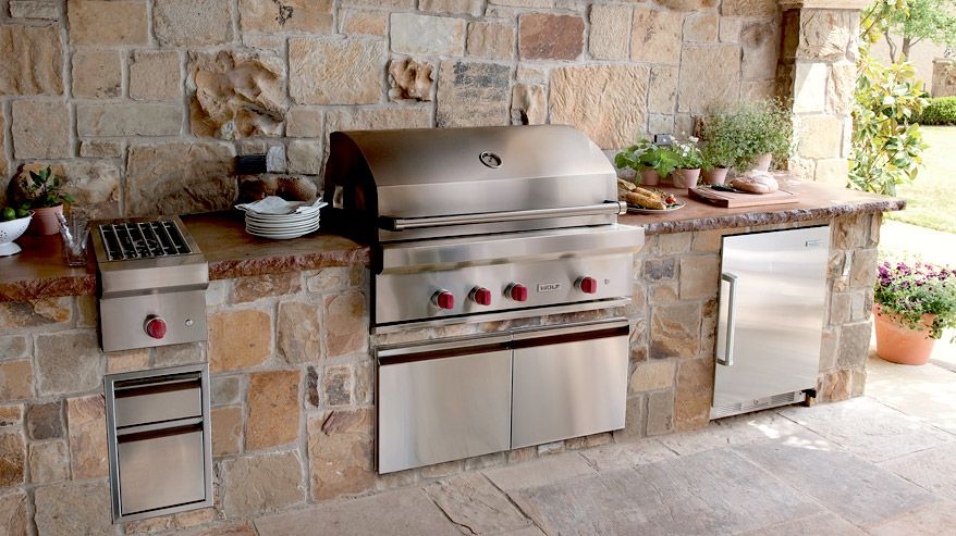 Outdoor kitchen with Wolf BBQ grill, burner module, and Sub-Zero ...