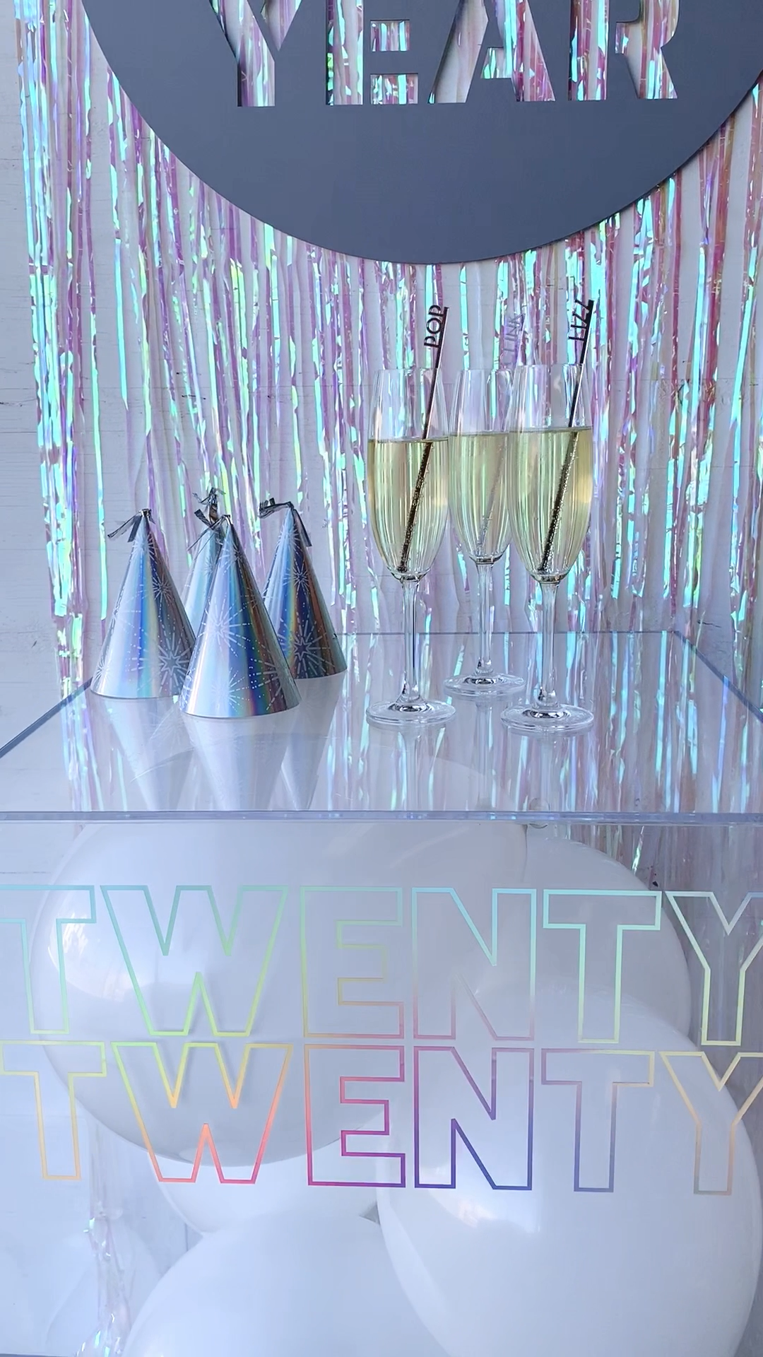 We love the current trend of all things iridescent & holographic, so we went all out with it for our decor. Think: a disco ball that exploded everywhere.  #newyearseve #newyearseveparty #newyears2020 #nye2020 #iridescent #holographic