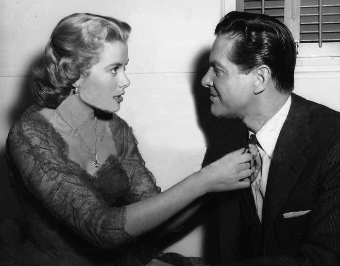 "Grace Kelly straightens Robert Cumming's tie before a scene in ""DIAL M FOR MURDER"" (1954) #GraceKelly"