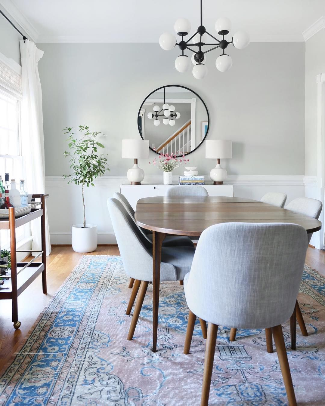 Mid Century Modern Dining Room With Accents Of Blue In A Vintage