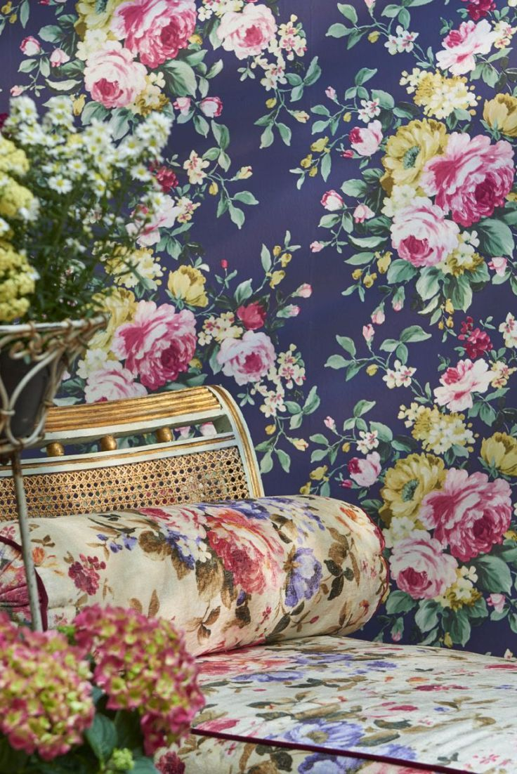 A large scale, bold, multicoloured floral wallpaper