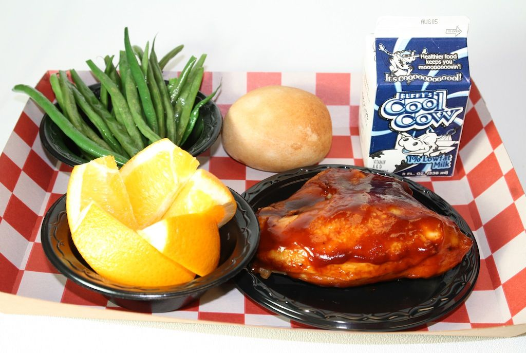 Bbq chicken green beans roll fruit and milk from