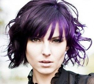 Gorgeous short curly hair style with purple highlights.