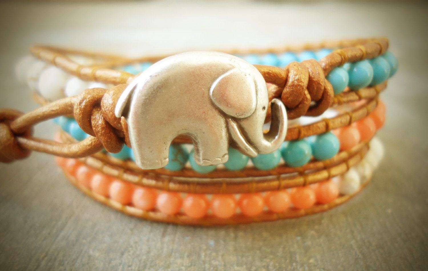 The Good Luck Elephant &  Coral, Turquoise, and Howlite Leather Wrap Bracelet. $39.00, via Etsy.