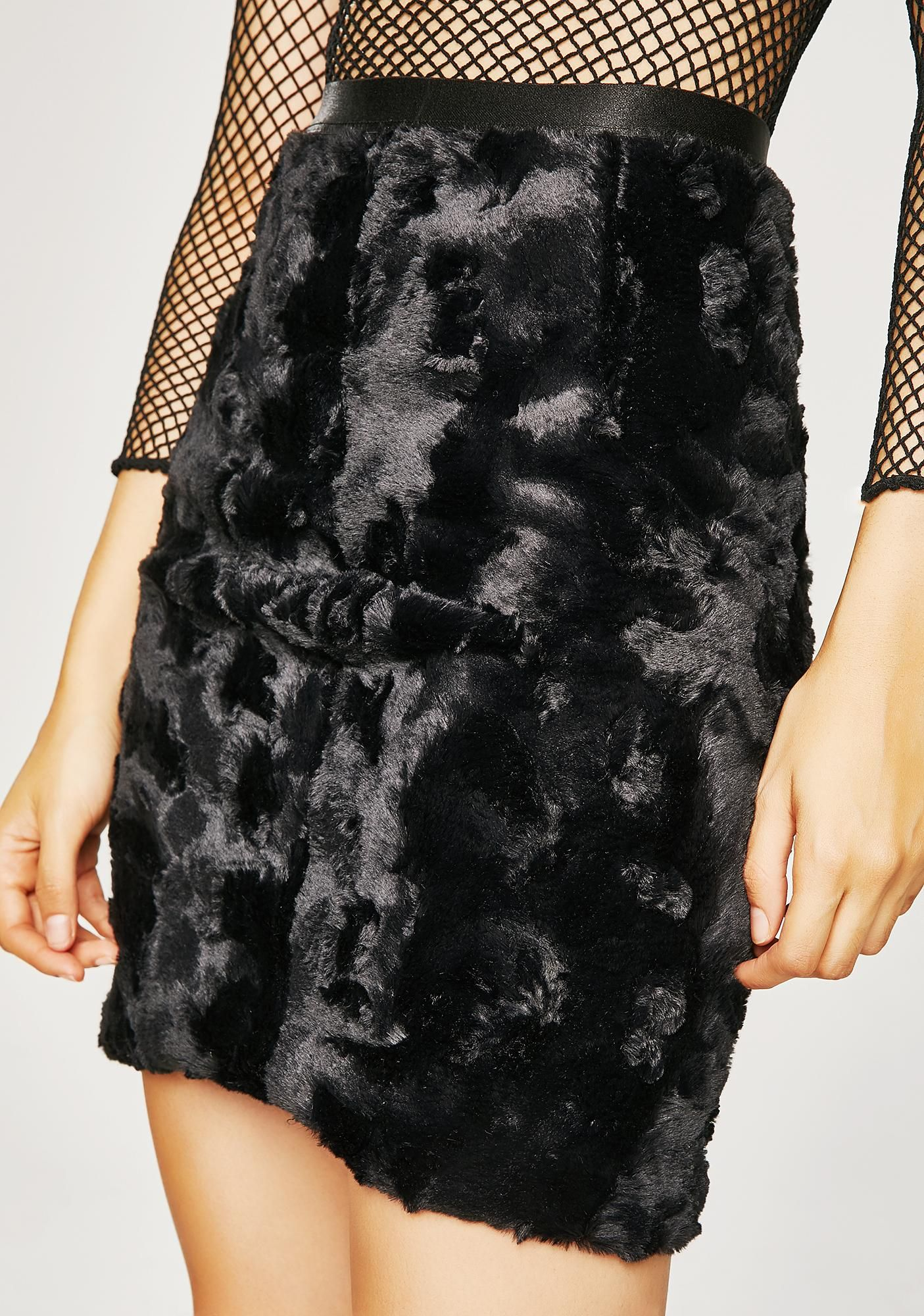 889e8834b89 Grizzly Bae Furry Skirt will make  em wanna snuggle with ya. This black  furry skirt has a mini fit with a zipper closure on the back.