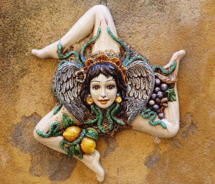 Trinacria The Classic Symbol Of Sicily With The Head Of A Woman