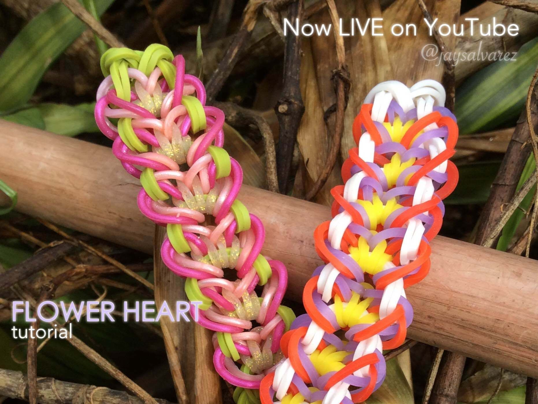 "The Rainbow Loom Star of The Week AI Enma (@ailovestoloom on Instagram) has created another beautiful bracelet. Check out the ""FLOWER HEART"" tutorial on my channel @jaysalvarez. Copyright © 2014 @jaysalvarez. Under no exceptions do we allow anyone to re-create, re-record, re-upload, or translate of my tutorials. For licensing my designs, please e-mail powercastam@gmail.com. #flowerheartbracelet #jaysalvarez #rainbowloom"