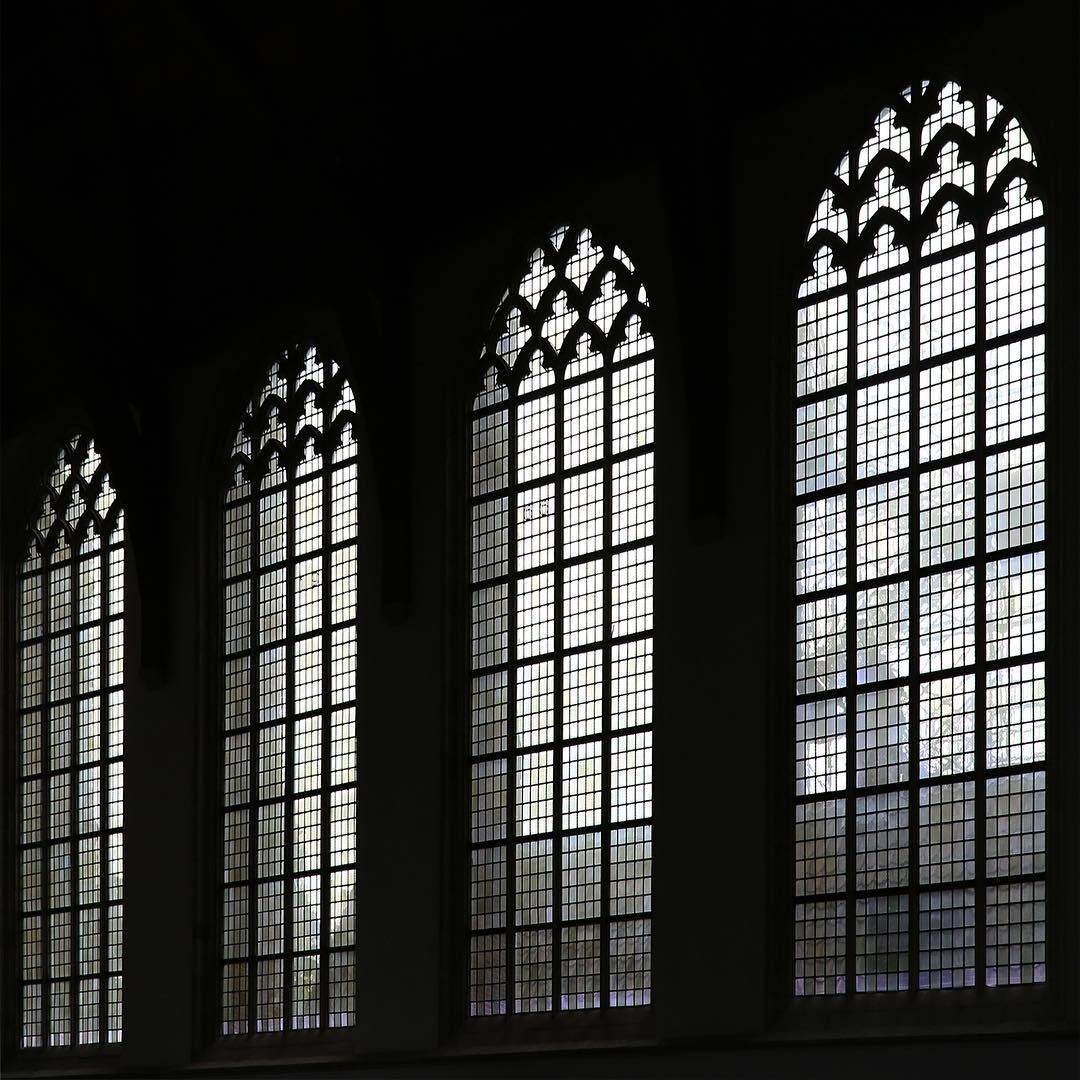 Windows of Hope . The 800-year-old Oude Kerk (old church) is Amsterdam's oldest building.