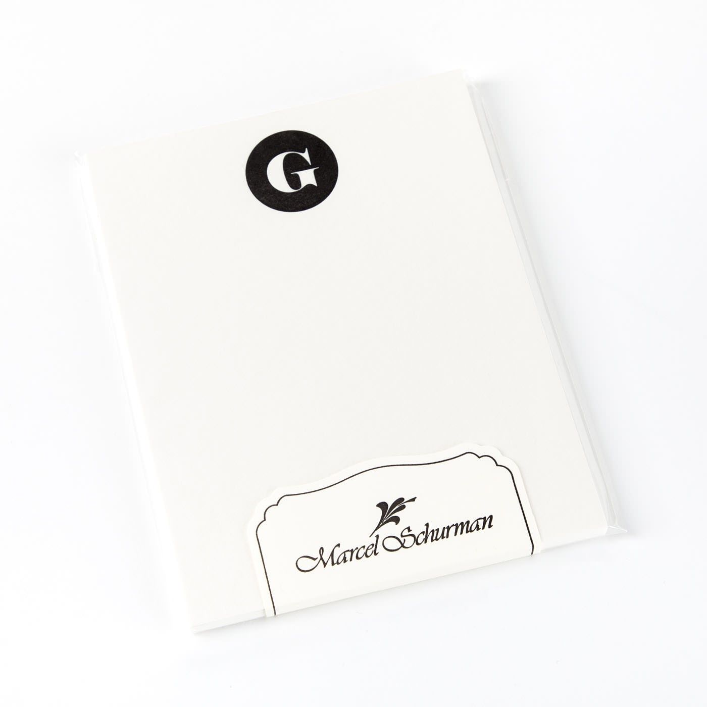 The Letter G Initial Is Letterpress Printed In A Circle