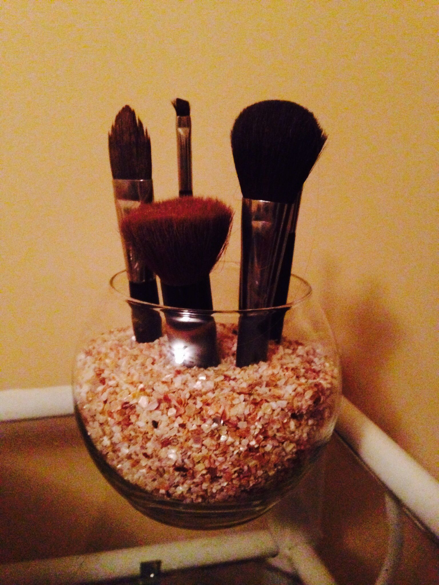 Dollar tree vase and pearl rocks to hold makeup brushes