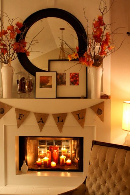 Fall mantle idea. Love the candles in the fireplace. May do this, seeing as my fireplace doesn't have a mantle. =/