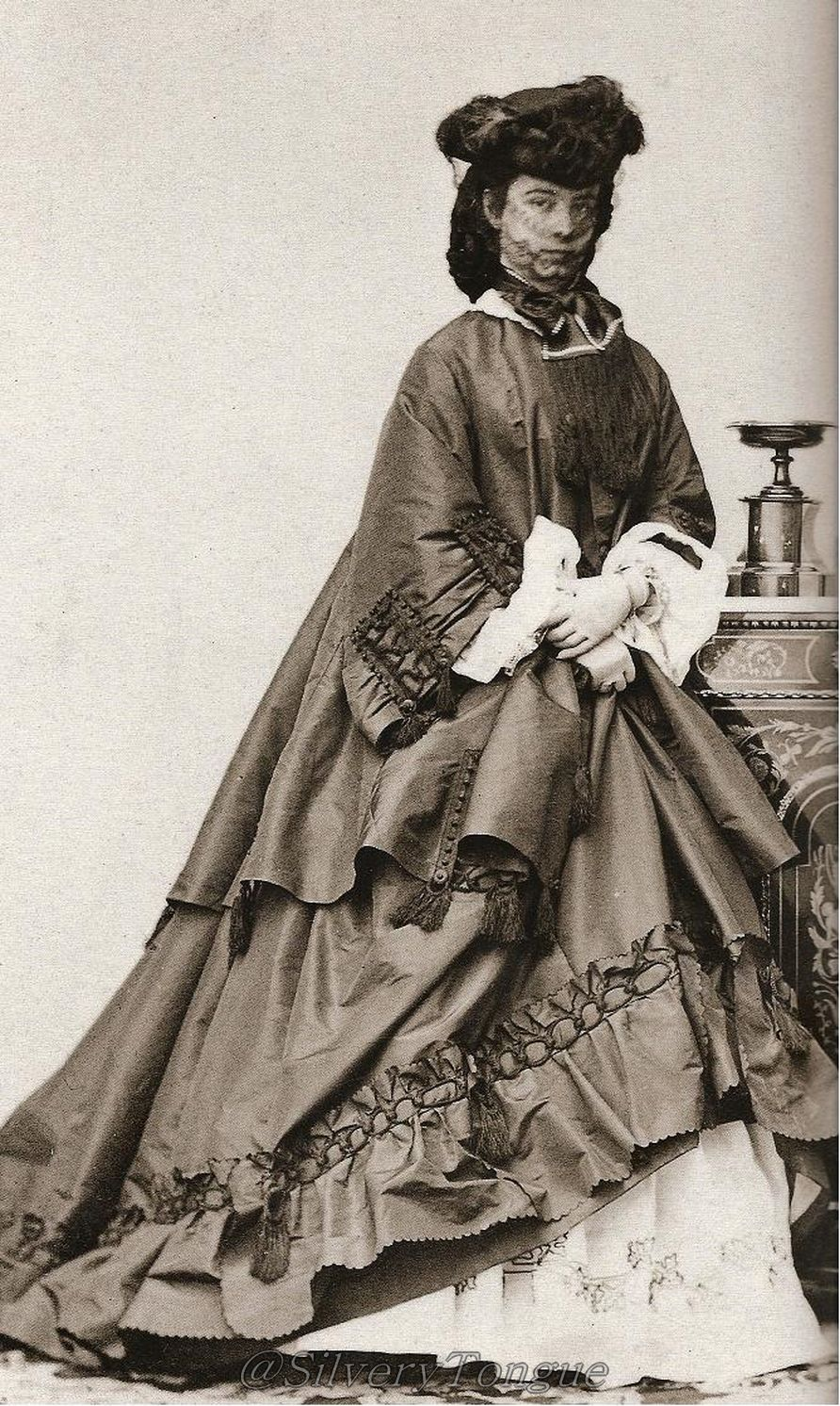Empress Elisabeth Looks At The Camera While Wearing A Hat And Outdoor Veil  In This Photo Amazing Design