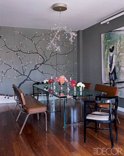 Fashion designer Adam Lippes covered one wall with a hand-painted 1920s-style wallpaper by Fromental depicting sparrows perched in a gnarled cherry tree.