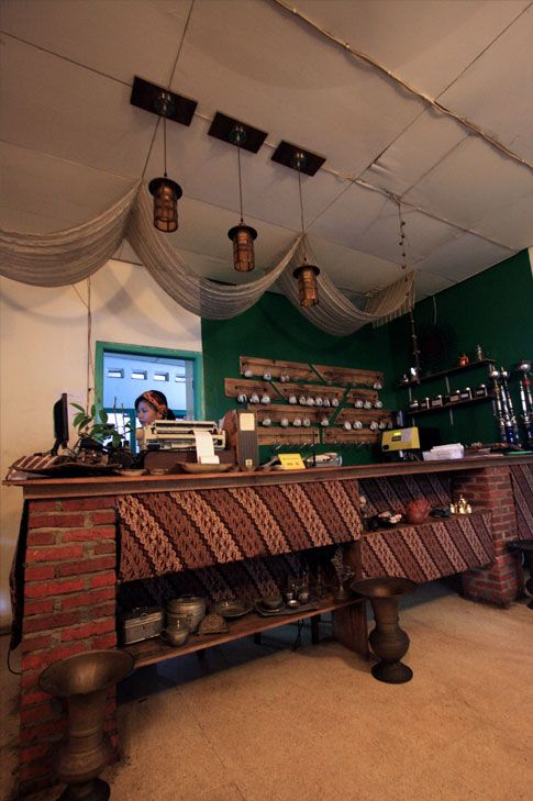 love this coffee shop interior with indonesian traditional touch textiles and props