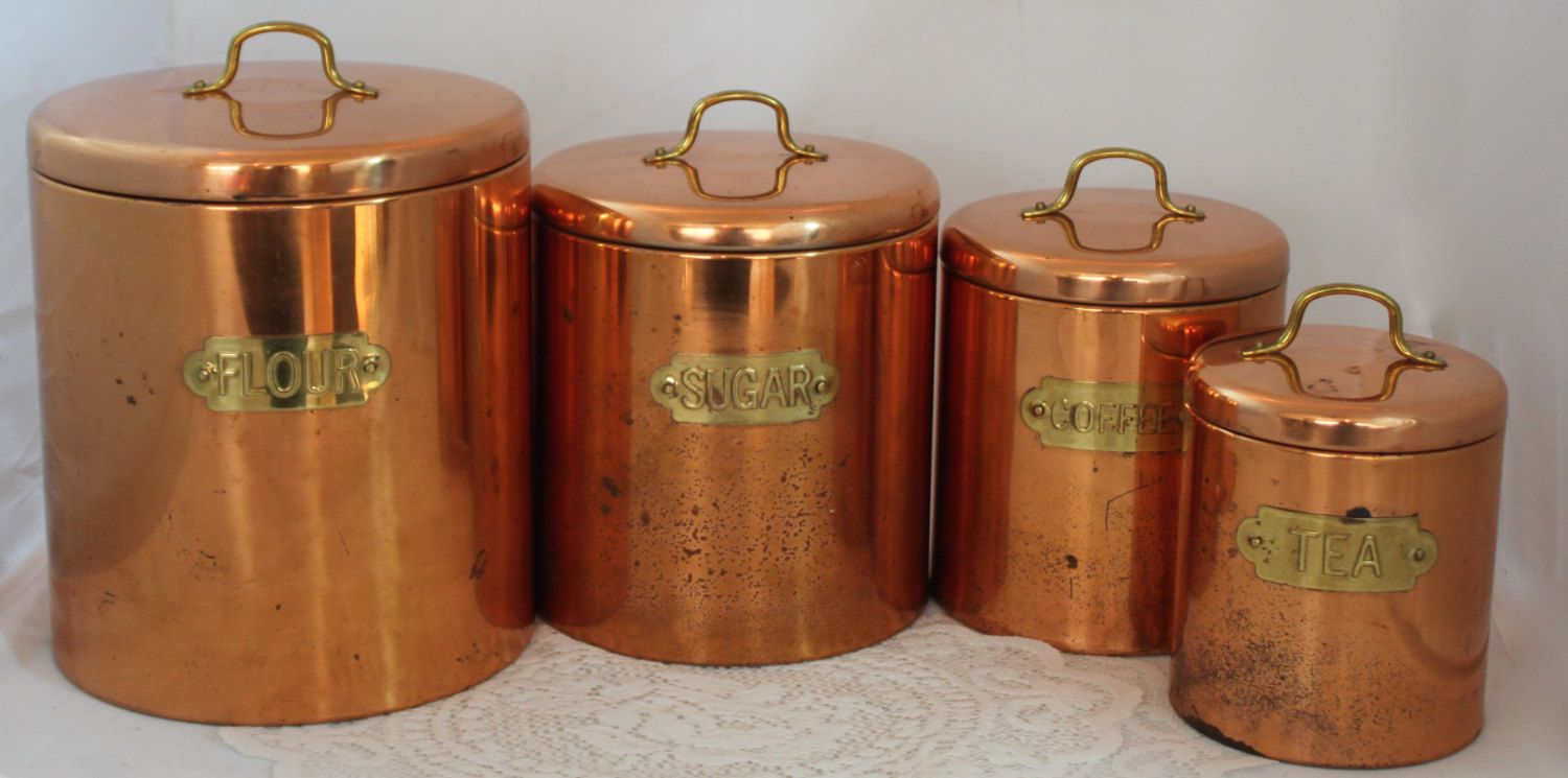 vintage odi copper canister set with brass tags and handles for