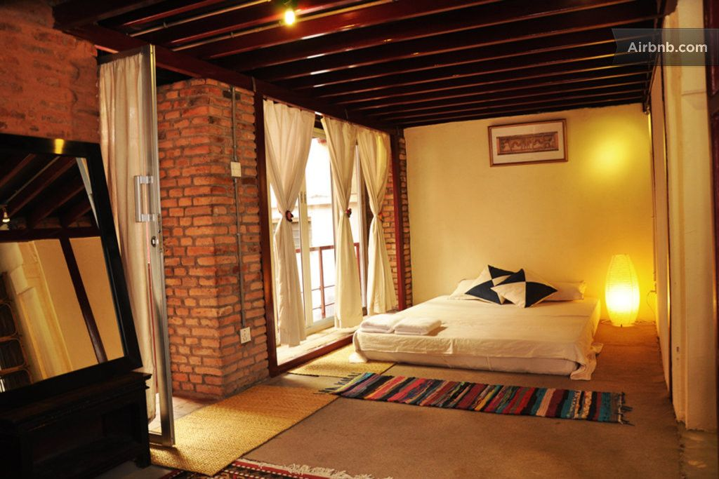 House In Lalitpur Nepal A Vast L Shaped Loft With A Bed Corner