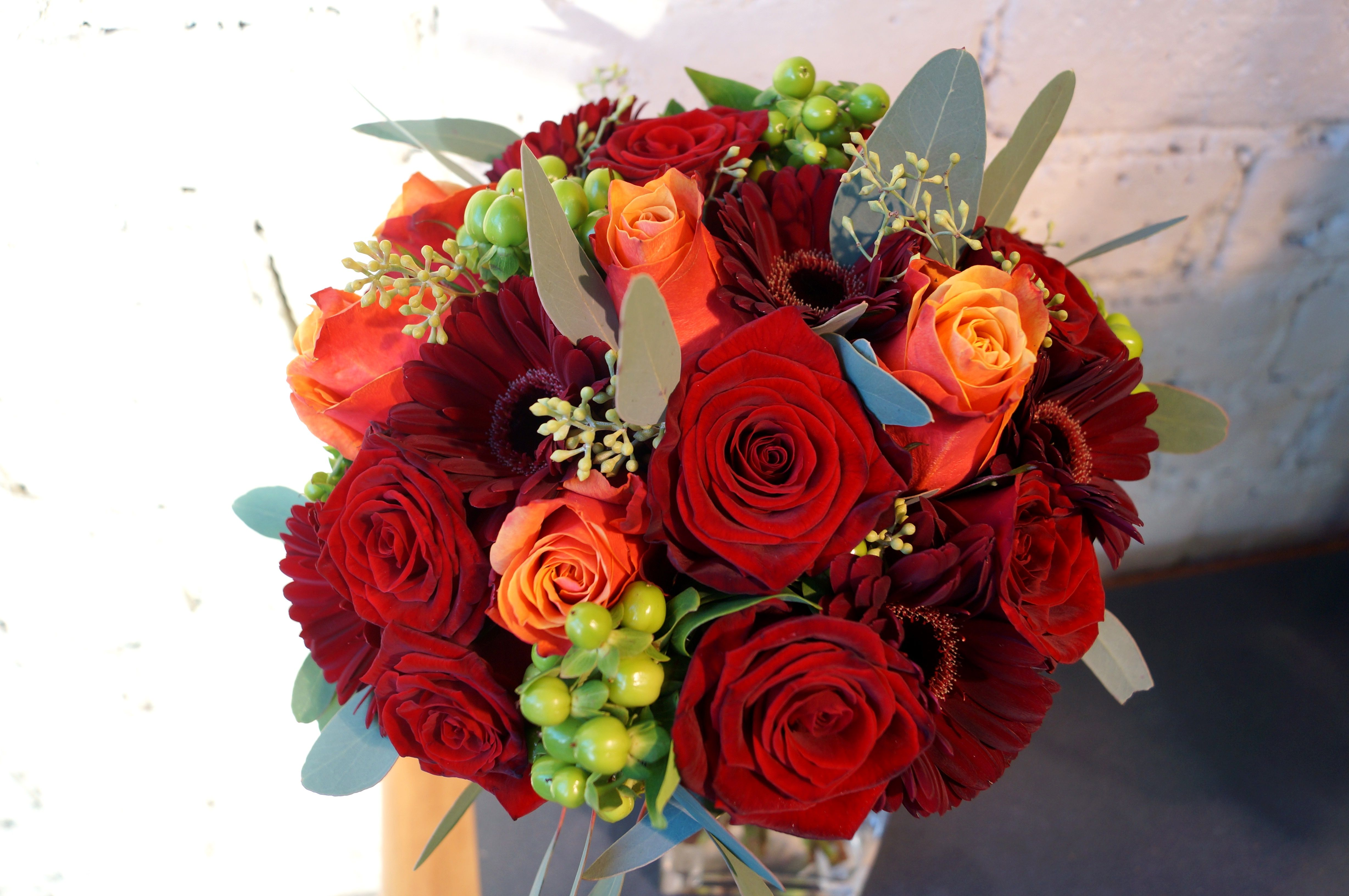 A stunning bridal bouquet with deep rich colours, flowers used ...