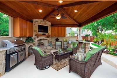 Covered Outdoor Kitchens And This Covered Porch In Austin With An Outdoor Kitchen Firep Outdoor Dining Room Outdoor Kitchen Design Covered Outdoor Kitchens